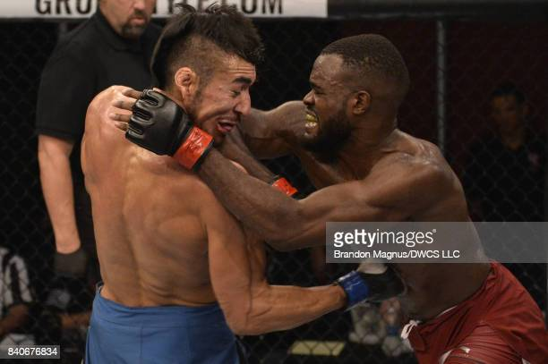 Bevon Lewis lands an elbow to the face of Elias Urbina in their middleweight bout during Dana White's Tuesday Night Contender Series at the TUF Gym...
