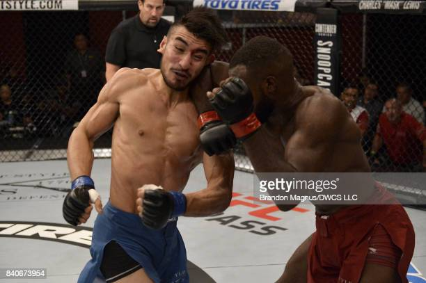 Bevon Lewis lands an elbow to the head of Elias Urbina in their middleweight bout during Dana White's Tuesday Night Contender Series at the TUF Gym...