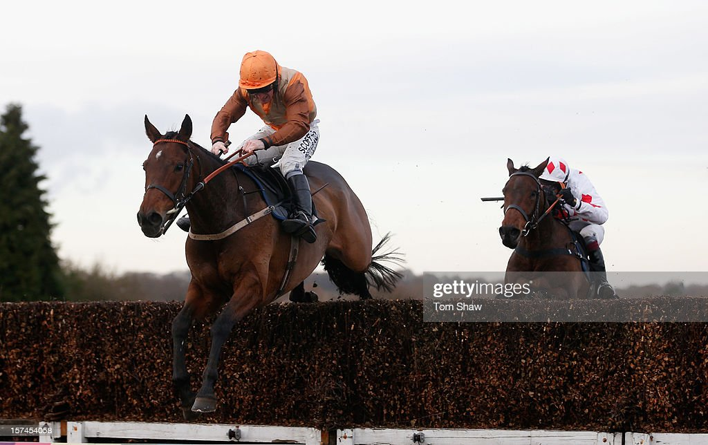Beware Chalk Pit ridden by Mark Grant jumps the final fence to win the Hopworth Wins National Handicap Steeple Chase at Plumpton Racecourse on December 3, 2012 in Plumpton, England.