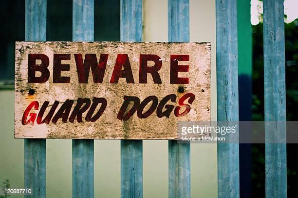 Beware guard dogs sign