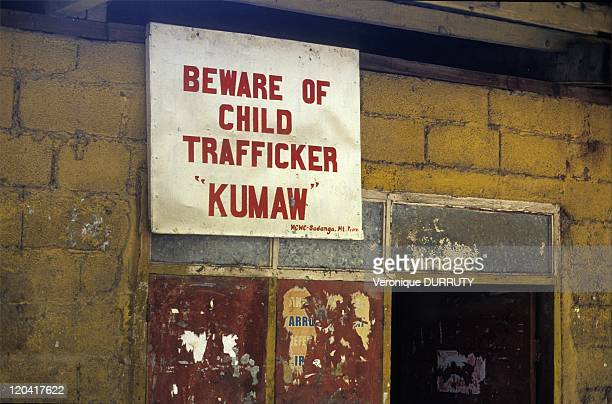 Beware of child trafficker ' Kuwa' board in a village of the Cordillera in north Luzon in Philippines The Philippines is a country where child...