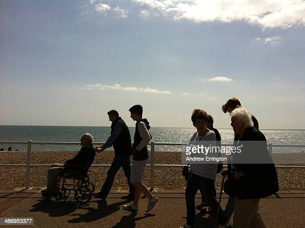 UK BexhillOnSea family outing silhouetted against the sea