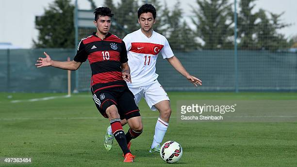 Beyhan Ametov of Germany vies with Kerem Bulut of Turkey during the U18 four nations friendly tournament match between Turkey and Germany at Emirhan...