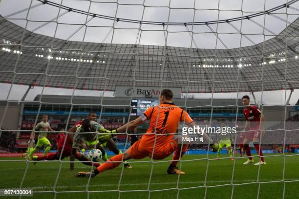 Beyhan Ametov of Koeln scores his team's first goal past Bernd Leno goalkeeper of Leverkusen to make it 01 during the Bundesliga match between Bayer...