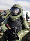 French Gendarmes wearing NBC equipment protecting from Nuclear Biological and Chemical attacks pose after a military antiterrorism exercise 02 March...
