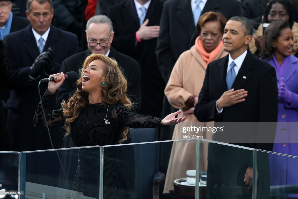 Beyoncé performs the national anthem as U.S. President Barack Obama looks on during the presidential inauguration on the West Front of the U.S. Capitol January 21, 2013 in Washington, DC. Barack Obama was re-elected for a second term as President of the United States.