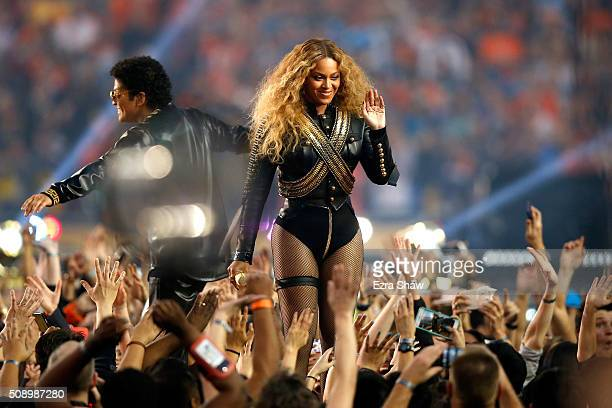 Beyonce and Bruno Mars perform during the Pepsi Super Bowl 50 Halftime Show at Levi's Stadium on February 7 2016 in Santa Clara California