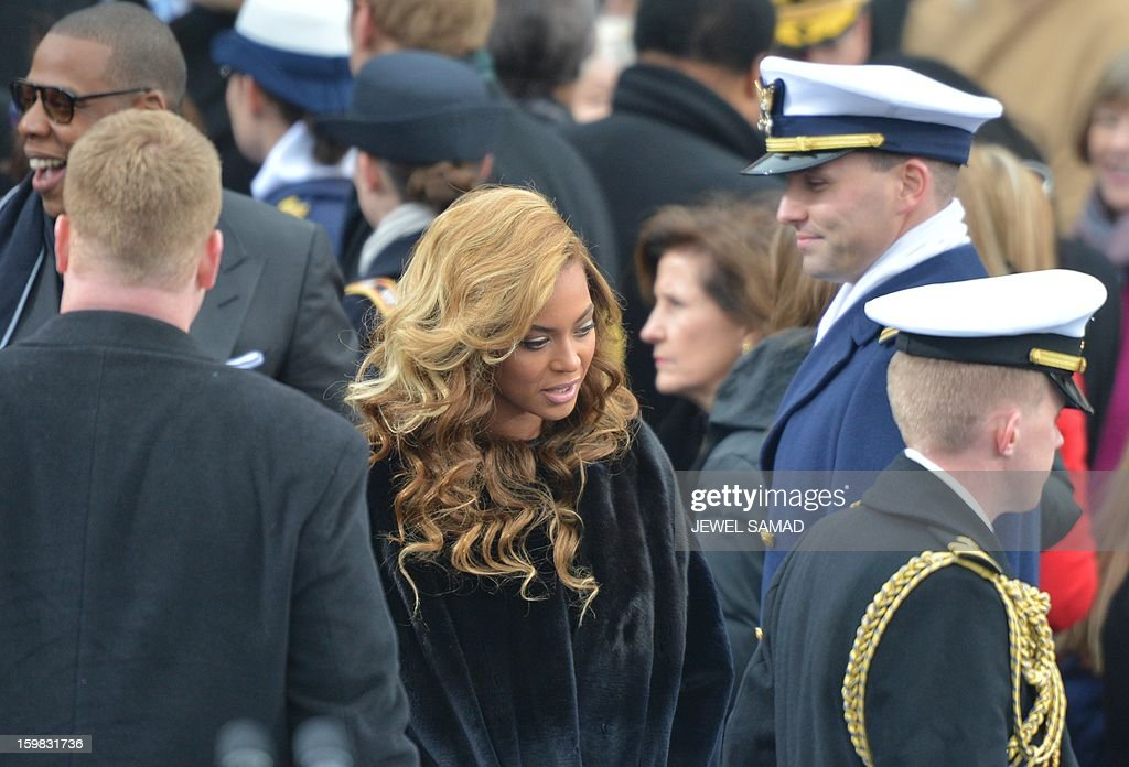 Beyonce and husband Jay-Z (far L) arrive for the 57th Presidential Inauguration ceremonial swearing-in of President Barack Obama at the US Capitol on January 21, 2013 in Washington, DC. The oath is to be administered by US Supreme Court Chief Justice John Roberts, Jr. AFP PHOTO/Jewel Samad