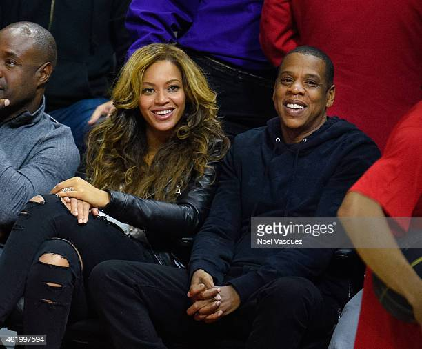 Beyonce and Jay Z attend a basketball game between the Brooklyn Nets and the Los Angeles Clippers at Staples Center on January 22 2015 in Los Angeles...
