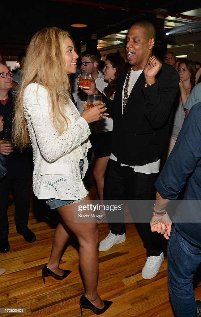 Beyonce and JAY Z attend JAY Z and Samsung Mobile's celebration of the Magna Carta Holy Grail album, available now through a customized app in Google Play and Samsung Apps exclusively for Samsung Galaxy S 4, Galaxy S III and Note II users on July 3, 2013 in Brooklyn City.