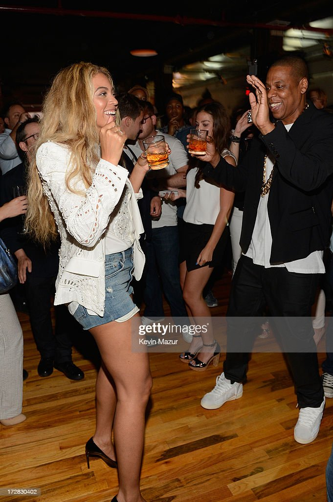 Beyonce and JAY Z attend JAY Z and Samsung Mobile's celebration of the Magna Carta Holy Grail album, available now through a customized app in Google Play and Samsung Apps exclusively for Samsung Galaxy S 4, Galaxy S III and Note II users on July 3, 2013 in Brooklyn, New York.