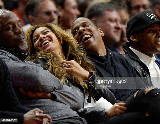 Beyonce and Jay Z laugh during the game between the Brooklyn Nets and the Los Angeles Clippers at Staples Center on January 22 2015 in Los Angeles...