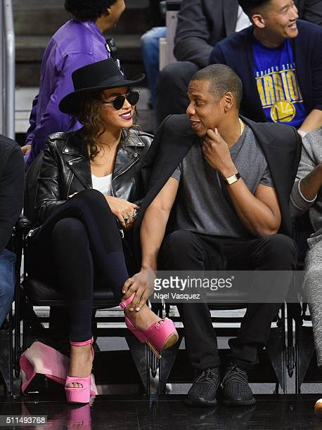Beyonce and JayZ attend a basketball game between the Golden State Warriors and the Los Angeles Clippers at Staples Center on February 20 2016 in Los...