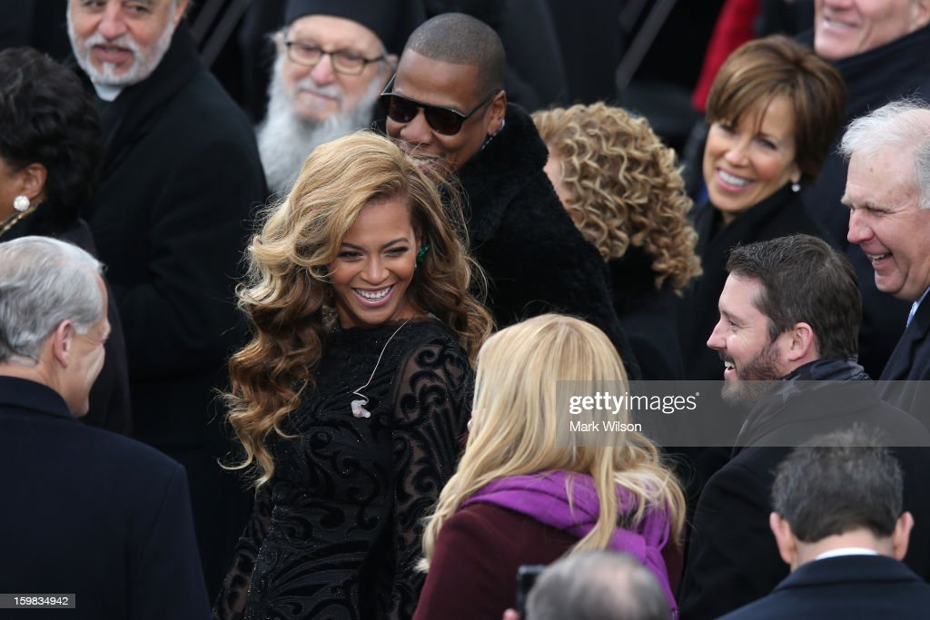 Beyonce and Jay-Z share a laugh with singer Kelly Clarkson during the public ceremonial inauguration for U.S. President Barack Obama on the West Front of the U.S. Capitol January 21, 2013 in Washington, DC. Barack Obama was re-elected for a second term as President of the United States.