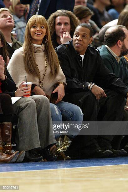 Beyonce and JayZ sit courtside at the New York Knicks vs Houston Rockets NBA game at Madison Square Garden on January 21 2005 in New York City NOTE...