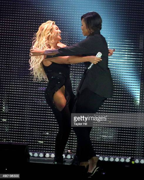 Beyonce and Michelle Obama hug during the 2015 Global Citizen Festival at Central Park on September 26 2015 in New York City