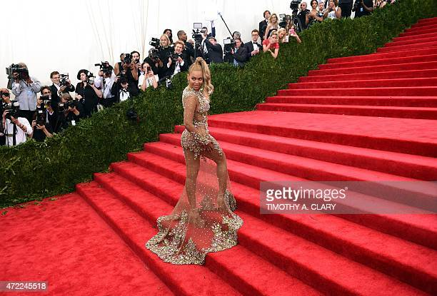 Beyonce arrives at the 2015 Metropolitan Museum of Art's Costume Institute Gala benefit in honor of the museums latest exhibit China Through the...