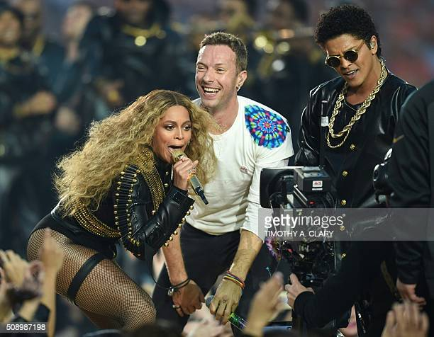 Beyonce Chris Martin and Bruno Mars perform during Super Bowl 50 between the Carolina Panthers and the Denver Broncos at Levi's Stadium in Santa...