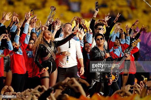 Beyonce Chris Martin of Coldplay and Bruno Mars perform during the Pepsi Super Bowl 50 Halftime Show at Levi's Stadium on February 7 2016 in Santa...