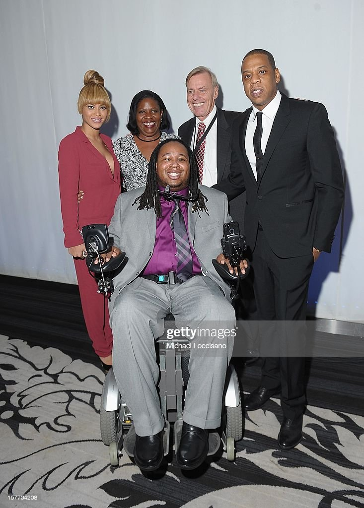 Beyonce, Former professional football player Eric LeGrand and Jay-Z attend the 2012 Sports Illustrated Sportsman of the Year award presentation at Espace on December 5, 2012 in New York City.