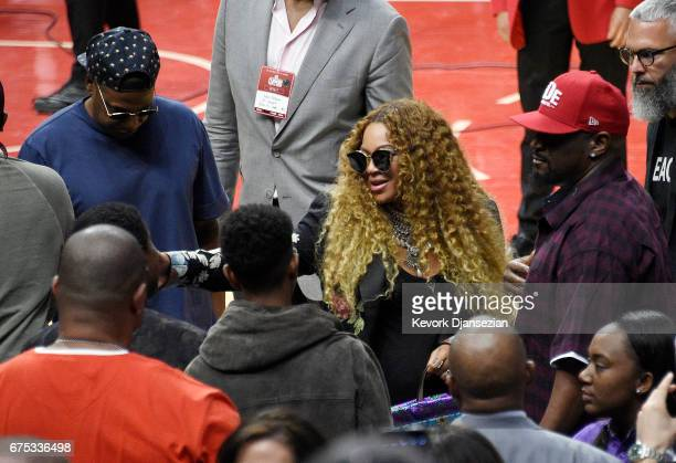 Beyonce greets songwriter/record producer Kenny 'Babyface' Edmonds and his son Dylan Michael Edmonds with Jay Z looking on after attend Game Seven of...