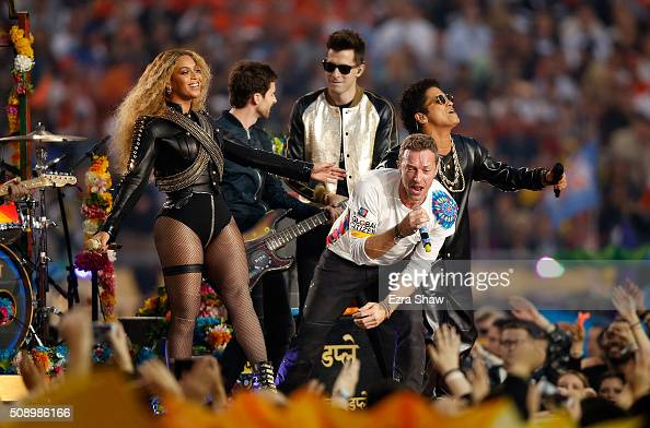 Beyonce Guy Berryman of Coldplay Chris Martin of Coldplay Mark Ronson and Bruno Mars perform during the Pepsi Super Bowl 50 Halftime Show at Levi's...