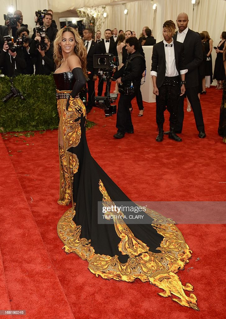 "Beyonce, honorary chairwoman, arrives at the Metropolitan Museum of Art's Costume Institute Gala benefit in honor of the museum's latest exhibit, ""Punk: Chaos to Couture."" May 6, 2013 in New York. AFP PHOTO/Timothy A. CLARY"