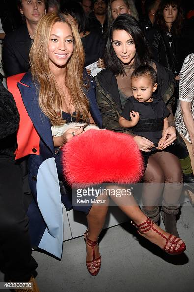 Beyonce Kim Kardashian and daughter North attend the adidas Originals x Kanye West YEEZY SEASON 1 fashion show during New York Fashion Week Fall 2015...
