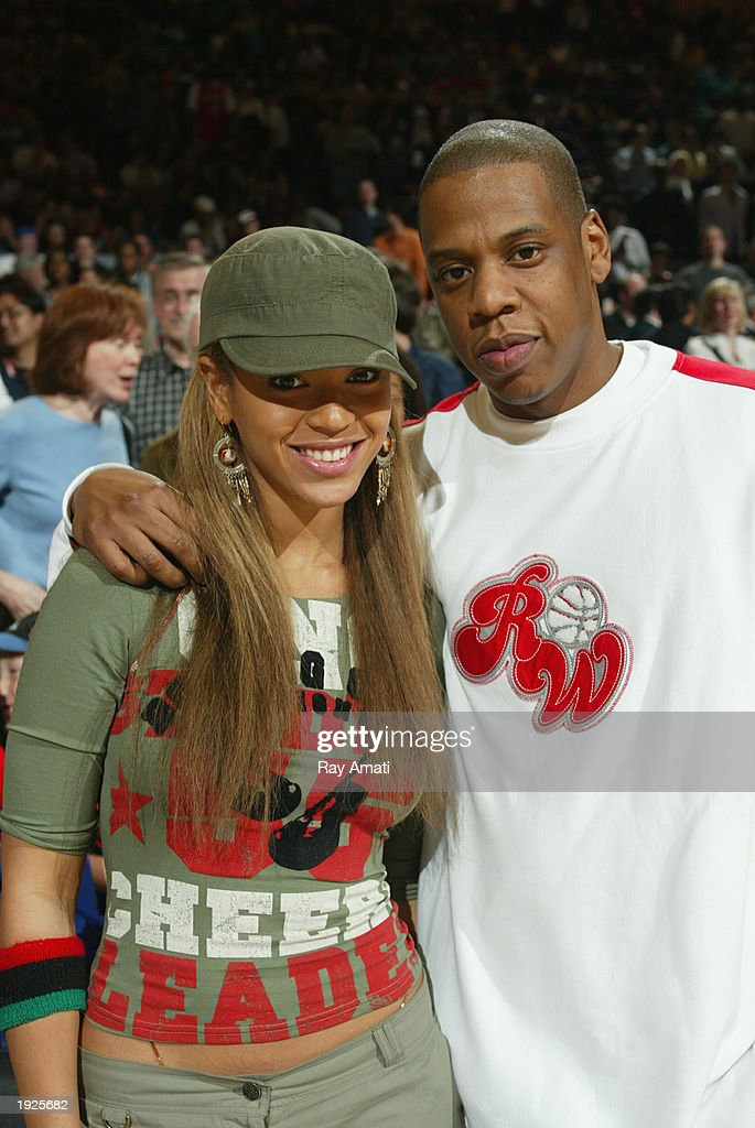 Beyonce Knowles and Jay Z poses as the Philadelphia 76ers visit the New York Knicks at Madison Square Garden on April 11, 2003 in New York, New York.