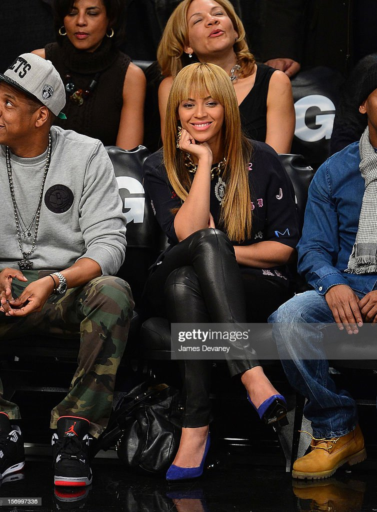 Beyonce Knowles (C) and Jay-Z (L) attend the New York Knicks v Brooklyn Nets game at Barclays Center on November 26, 2012 in the Brooklyn borough of New York City.