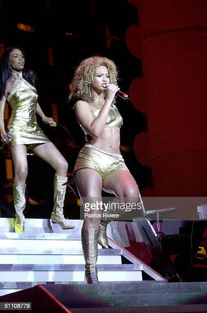 Beyonce Knowles and Michelle Williams of American band Destiny's Child in concert at The Sydney Entertainment Centre in Sydney Australia