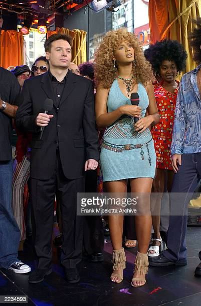 Beyonce Knowles and Mike Myers on MTV TRL to promote the film 'Austin Powers in Goldmember' at the MTV Times Square Studios in New York City July 26...