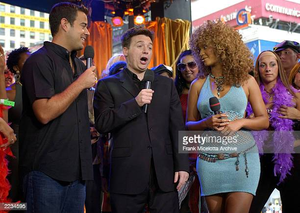 Beyonce Knowles and Mike Myers with host Carson Daly on MTV TRL to promote the film 'Austin Powers in Goldmember' at the MTV Times Square Studios in...