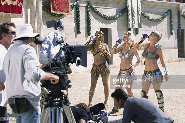 Beyonce Knowles Britney Spears and Pink drink Pepsi during the making of the Pepsi music commercial 'Pepsi Gladiators' in Rome on September 22 2003...