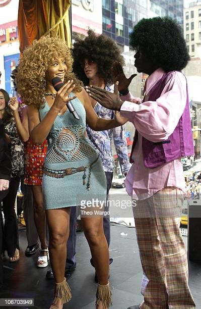 Beyonce Knowles dancing with TRL audience member during Mike Myers and Beyonce Knowles Visit MTV's 'TRL' to promote 'Austin Powers in Goldmember'...