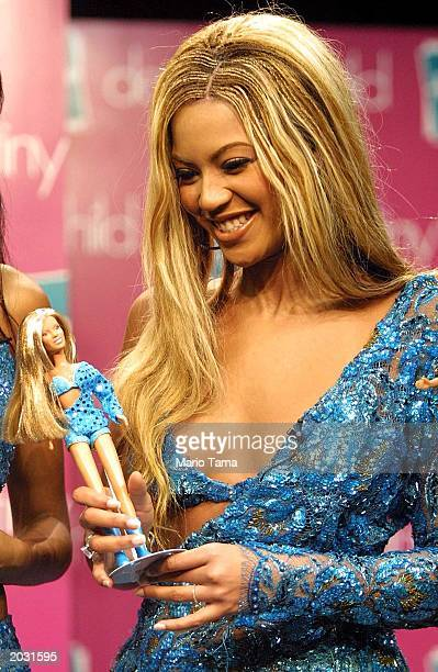 Beyonce Knowles of the pop music group Destiny's Child holds her new Destiny's Child doll from Hasbro Inc September 6 2001 in New York City