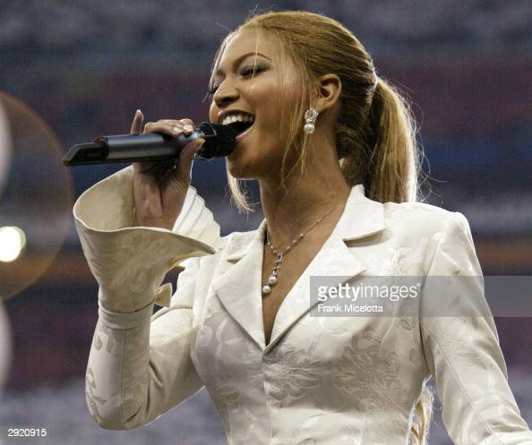 Beyonce Knowles sings the National Anthem prior to the start of Super Bowl XXXVIII between the New England Patriots and the Carolina Panthers at...