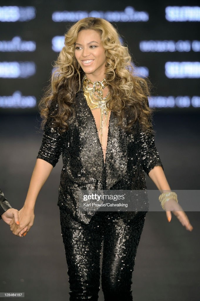 Beyonce Knowles walks the runway at the end of her runway presentation for House of Dereon by Beyonce and Tina Knowles during London Fashion Week on...