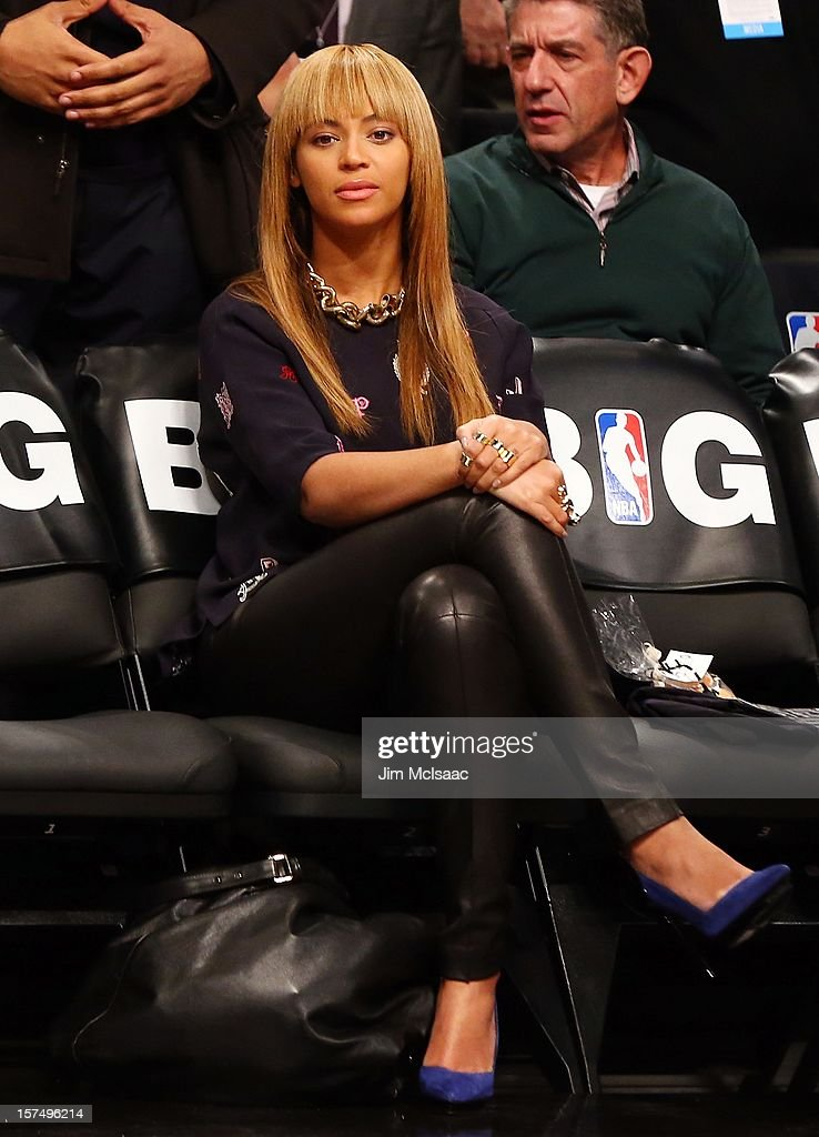 Beyonce looks on before the Brooklyn Nets play against the New York Knicks at Barclays Center on November 26, 2012 in the Brooklyn borough of New York City.The Nets defeated the Knicks 96-89 in overtime.