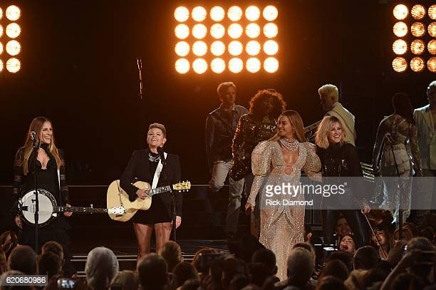 Beyonce performs onstage with Emily Robison Natalie Maines and Martie Maguire of Dixie Chicks at the 50th annual CMA Awards at the Bridgestone Arena...