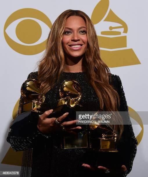 Beyonce poses with her three Grammys in the press room during the 57th annual Grammy Awards in Los Angeles California on February 8 2015 Beyonce won...