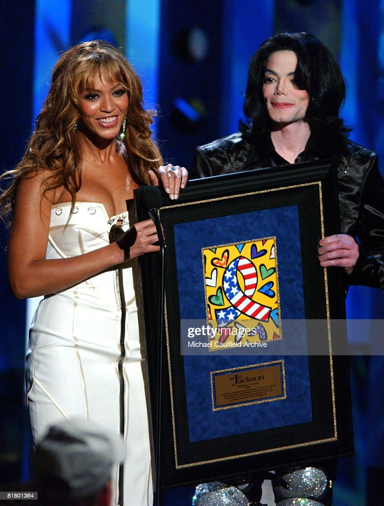 Beyonce presents the humanitarian award to <a gi-track='captionPersonalityLinkClicked' href=/galleries/search?phrase=Michael+Jackson&family=editorial&specificpeople=70011 ng-click='$event.stopPropagation()'>Michael Jackson</a> at the 2003 Radio Music Awards