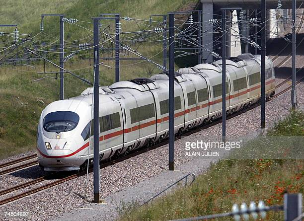 A German highspeed train's ICE runs toward Bezannes railway station 10 June 2007 eastern France Trains from French stateowned rail company SNCF and...