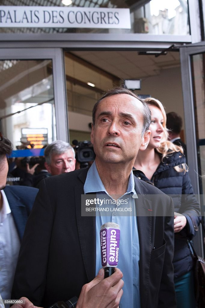 Beziers' mayor Robert Menard (front) and French far-right Front National (FN) party member of parliament Marion Marechal-Le Pen (R) leave the Palais des Congres in Beziers, southern France, on May 28, 2016 during 'Le Rendez-vous de Beziers' political meeting. Menard launched his own political movement 'Oz ta Droite'. / AFP / BERTRAND