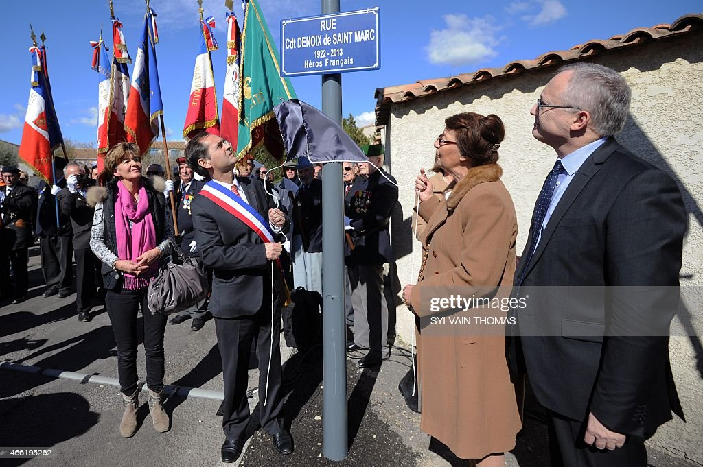 Beziers Mayor supported by the French far-right Front National party (FN - National Front), <a gi-track='captionPersonalityLinkClicked' href=/galleries/search?phrase=Robert+Menard&family=editorial&specificpeople=554783 ng-click='$event.stopPropagation()'>Robert Menard</a> (2ndL) attends the unveiling of a renamed street name sign 'rue du commandant Helie Denoix de Saint-Marc', who took part in the Algiers putsch of 1961, on March 14, 2015 in Bezier, southern France. The street was previsouly named 'rue du 19 mars 1962' (March 1962 street), the date of the Evian Accords, which ended the Algerian War.