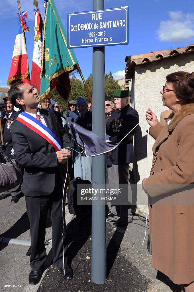 Beziers Mayor supported by the French far-right Front National party (FN - National Front), <a gi-track='captionPersonalityLinkClicked' href=/galleries/search?phrase=Robert+Menard&family=editorial&specificpeople=554783 ng-click='$event.stopPropagation()'>Robert Menard</a> (L) attends the unveiling of a renamed street name sign 'rue du commandant Helie Denoix de Saint-Marc', who took part in the Algiers putsch of 1961, on March 14, 2015 in Bezier, southern France. The street was previsouly named 'rue du 19 mars 1962' (March 1962 street), the date of the Evian Accords, which ended the Algerian War.