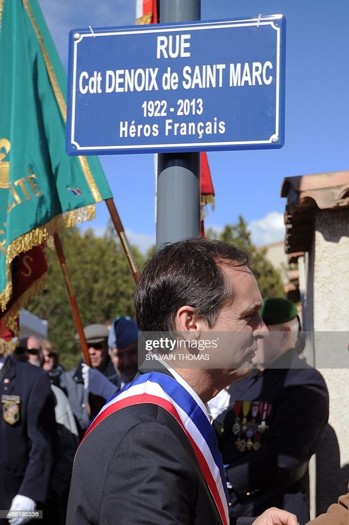 Beziers Mayor supported by the French far-right Front National party (FN - National Front), <a gi-track='captionPersonalityLinkClicked' href=/galleries/search?phrase=Robert+Menard&family=editorial&specificpeople=554783 ng-click='$event.stopPropagation()'>Robert Menard</a> attends the unveiling of a renamed street name sign 'rue du commandant Helie Denoix de Saint-Marc', who took part in the Algiers putsch of 1961, on March 14, 2015 in Bezier, southern France. The street was previsouly named 'rue du 19 mars 1962' (March 1962 street), the date of the Evian Accords, which ended the Algerian War.