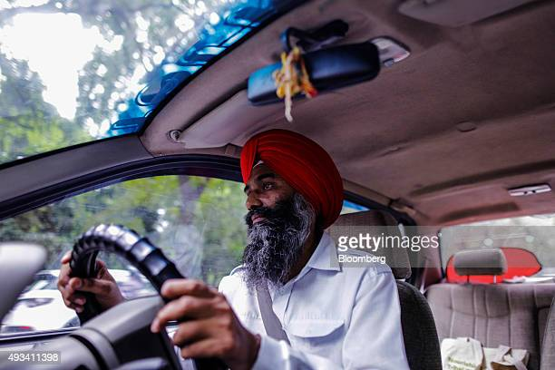 Bhag Singh a driver for the Uber Technologies Inc ridehailing service drives a taxi in New Delhi India on Friday Sept 18 2015 Uber expects to have...