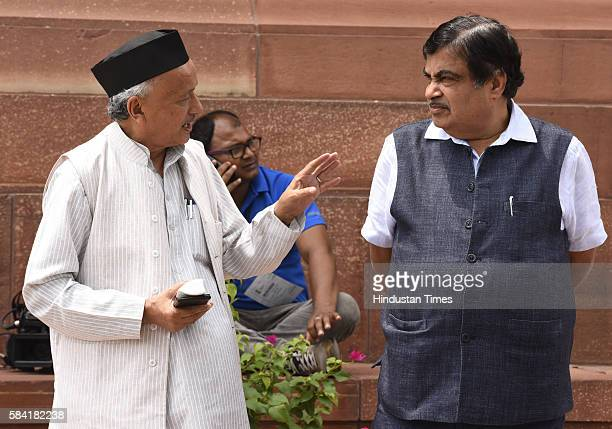 Bhagat Singh Koshyari BJP MP talking to Union Minister of Road Transport and Highways Shipping Nitin Jairam Gadkari during the Parliament Monsoon...