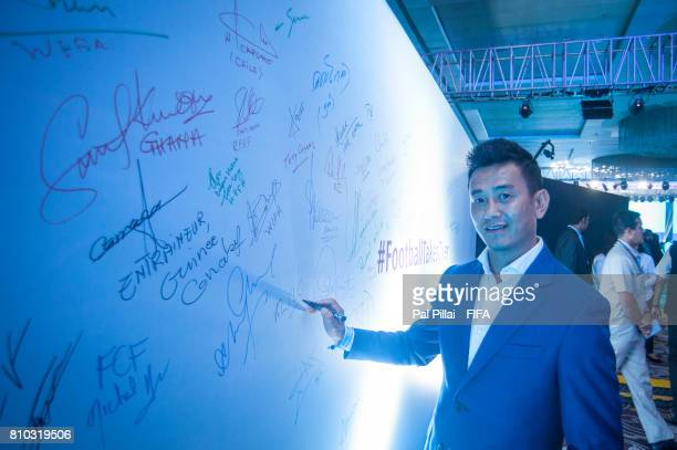 Bhaichung Bhutia former Indian Football players signing a message during FIFA U17 World Cup 2017 Draw held at Hotel Sahara Star on July 07 2017 in...